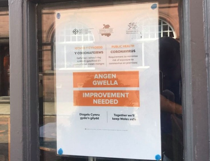 Improvement notice on the window at Chequers in Wrexham